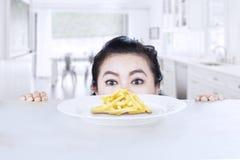 Young woman peeking french fries Stock Image