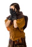 Young woman peeking through hands covering face Stock Photography