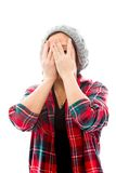 Young woman peeking through hands covering face Royalty Free Stock Images