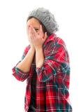 Young woman peeking through hands covering face Stock Photos