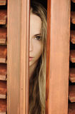 Young woman peeking Royalty Free Stock Image