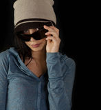 Young woman peeking through sunglasses Stock Photo