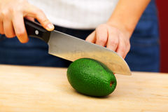 Young woman peeling avocado Stock Photography