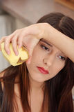 Young woman peeling potato Royalty Free Stock Photos
