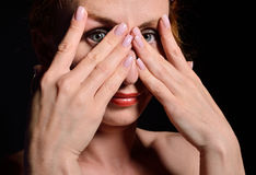 Young woman peeping Stock Photo