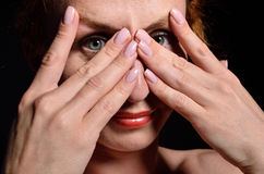 Young woman peeping Royalty Free Stock Photo