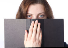 The Eyes and the Book Royalty Free Stock Photos