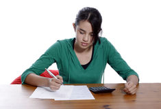 A young woman with pen Royalty Free Stock Image