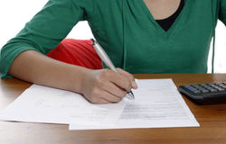 A young woman with pen Stock Images
