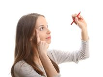 Young woman with pen Stock Photos