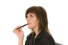 Young woman with pen. Young woman holding a pen with the tip in her mouth clearly thinking about a problem Stock Photos