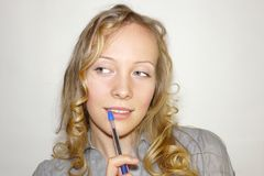 Young woman with a pen Stock Photo