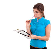 Young woman with pen and clipboard Stock Photos