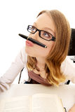 Young woman with pen on mouth Stock Photo