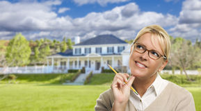 Young Woman With Pencil in Front of House Stock Images