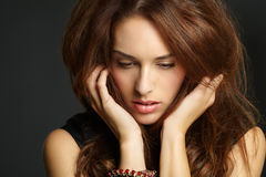 Young Woman. Pensive woman with big hair Stock Photography