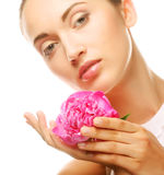 Young woman with peony flower Stock Photos