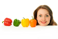 Young woman with peppers Stock Photo