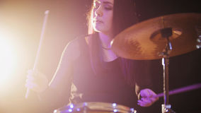 Young woman percussion drummer performing with drums. Close up stock images