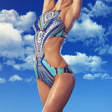 Young woman with perfect body in swimsuit Royalty Free Stock Photo