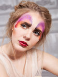 Young woman with perfect butterfly make up Stock Image