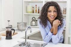 Young Woman Perfect Teeth and Smile in Kitchen stock photos