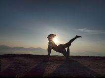 Young woman perform Yoga on the cliff in morning Royalty Free Stock Photography