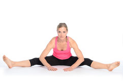 Free Young Woman Performing A Straddle Split Stretch Royalty Free Stock Photos - 78905998