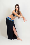 Young woman a performing belly dancing. full height Royalty Free Stock Images