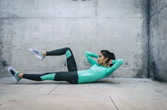 Young woman performing core crunch exercise Stock Photography
