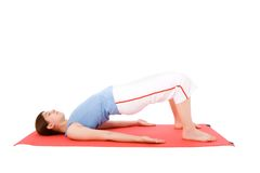 Young woman performing fitness exercises Royalty Free Stock Images