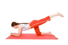Young woman performing fitness exercises Stock Photo