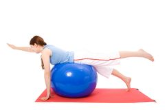 Young woman performing fitness exercises Royalty Free Stock Photography