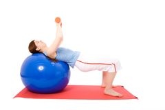Young woman performing fitness exercises Stock Photos