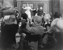 Young woman performing for a group of spectators Royalty Free Stock Images