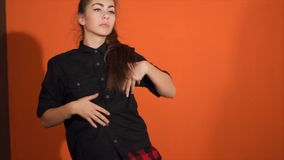Young woman performing hip-hop dance in studio. Hip-hop culture. Expressive modern dance in motion. Slow motion stock video footage