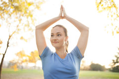 Young woman performing yoga positions Stock Image