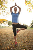 Young woman performing yoga positions Royalty Free Stock Images