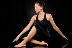 Young woman performing yoga with stretched arms Royalty Free Stock Images