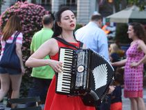 A Young Woman Performs Music with her Accordion stock image