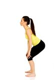 Young woman performs squats. Royalty Free Stock Images