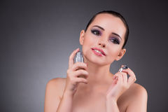 The young woman with perfume in beauty concept Royalty Free Stock Photo