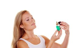 Young woman with perfume bottle Royalty Free Stock Photography