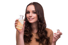 The young woman with perfume bottle isolated on white Stock Image