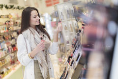 Young woman in perfumery Stock Images