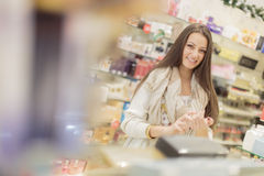 Young woman in perfumery Royalty Free Stock Images