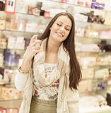 Young woman in perfumery Stock Photos