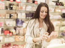 Young woman in perfumery. Pretty young woman in perfumery Stock Images