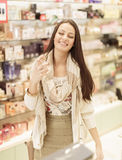 Young woman in perfumery Royalty Free Stock Image