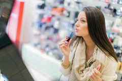 Young woman in perfumery Royalty Free Stock Photos
